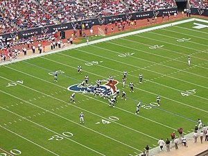 The Tennessee Titans and the Houston Texans in formation before a play
