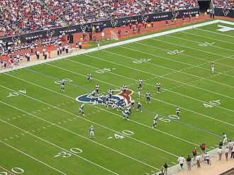 American football rules - The Tennessee Titans and the Houston Texans in formation before a play.