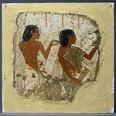 Tomb painting depicting two priests, one holding a papyrus roll and the other a vase for libations (...