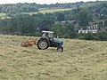 Tractor turning hay, near Great Missenden - geograph.org.uk - 193986.jpg