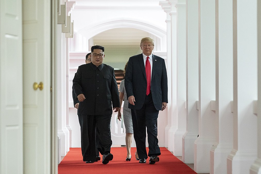 Trump and Kim walk to the Summit Room.jpg