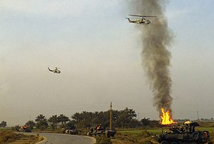 Two USMC AH-1W provides close air support during Operation IRAQI FREEDOM.jpg