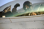 U.S. Air Force Capt. Travis Boltjes, a fighter pilot with the 175th Fighter Squadron, South Dakota Air National Guard, prepares to fly a Block 30 F-16 Fighting Falcon aircraft from Joint Base Balad, Iraq, to his 100822-F-WT236-029.jpg