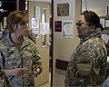 U.S. Army Lt. Col. Rebecca Young, left, a nurse practitioner with the Alaska Army National Guard, discusses exercise Arctic Care medical operations with Mongolian Armed Forces Maj. Naranzul Tumurbaatar 120415-F-ZH346-002.jpg