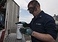 U.S. Navy Aviation Support Equipment Technician 3rd Class Justin West applies lubricant to an oil filter for a P25 fire truck aboard the aircraft carrier USS Harry S. Truman (CVN 75) May 20, 2013, in 130520-N-IG780-032.jpg