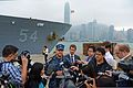 U.S. Navy Capt. Tom Disy, center, the commanding officer of the guided missile cruiser USS Antietam (CG 54), speaks to reporters in Hong Kong Nov. 12, 2013, before the ship departs for the Philippines 131112-N-TG831-149.jpg
