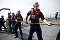 U.S. Navy Information System Technician 2nd Class Jacob Gabris heaves a line during an underway replenishment aboard the guided missile destroyer USS William P. Lawrence (DDG 110) Aug. 26, 2013, in the Arabian 130826-N-ZQ631-023.jpg