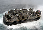 A US Navy LCAC hovercraft attached to the Amphibious assault ship USS Kearsarge
