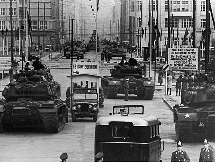 Soviet and American tanks face each other at Checkpoint Charlie during the Berlin Crisis of 1961. US Army tanks face off against Soviet tanks, Berlin 1961.jpg
