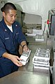 US Navy 021230-N-4655M-003 preparing leaflets that will be dropped over Iraq.jpg