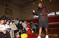 US Navy 030328-N-3503M-001 Former NBA player Jerome Kersey addresses a group of kids on the basketball court in the Naval Air Facility, Ranger Gym.jpg