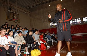 Jerome Kersey - In 2003, Jerome Kersey addresses a group of kids on the basketball court in the Naval Air Facility at Atsugi, Japan