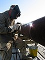 US Navy 030402-N-1050K-037 Steelworker Constructionman Patrick Lewis from Kenosha, Wis., is attached to Amphibious Construction Battalion Two (ACB-2) stationed at Little Creek, Va.jpg