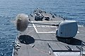 US Navy 030809-N-4304S-007 The guided missile destroyer USS John Paul Jones (DDG 53) fires a five-inch round from a Mk-45 5-inch gun (5 inch 54 cal.) during a live-fire exercise.jpg