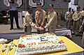 US Navy 040520-N-6536T-001 Command Master Chief C. Penton, left, Commanding Officer Capt. R. J. Gilman, middle, and Executive Officer Capt. W. L. Cone, right, cut a large commemorative cake on the flight deck aboard USS Nimitz.jpg