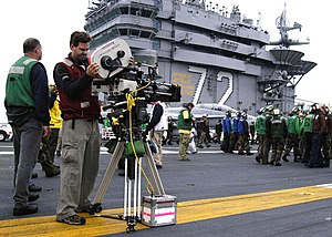 USS Abraham Lincoln (CVN-72) - A camera crew sets up for scenes from the movie Stealth to be filmed on the flight deck with the crew