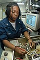 US Navy 040922-N-7695R-001 Electronics Technician 3rd Class Veronica Grooms of Fort Lauderdale, Fla., checks the electronic output signal levels on a NATO module in Combat System Six (CS-6).jpg