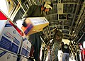 US Navy 050131-N-6074Y-158 Marines assigned to the Flying Tigers of Marine Medium Helicopter Squadron Two Six Two (HMM-262), move boxes of food out of the back of a CH-46E Sea Knight helicopter.jpg