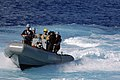 US Navy 050917-N-1332Y-189 Sailors return to the guided missile destroyer USS Fitzgerald (DDG 62) in a Rigid Hull Inflatable Boat (RHIB) after recovering a mock victim during a man overboard drill.jpg