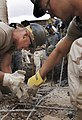 US Navy 060125-F-2902B-139 U.S. Navy Seabees remove debris from a building that collapsed on Nairobi's Ronald Ngala Street Kenya, Africa, Jan. 24, 2006.jpg