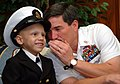 US Navy 060602-N-0962S-053 Master Chief Petty Officer of the Navy (MCPON) Terry Scott exchanges a few secrets between chiefs with seven-year-old Honorary Chief Hospital Corpsman Diego Santiago.jpg