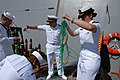 US Navy 070503-N-8273J-172 Sailors aboard USS New Orleans (LPD 18) pass out beads to represent the city of New Orleans during a homeport arrival ceremony for the ship at Naval Base San Diego.jpg