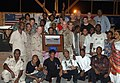 US Navy 070526-N-1003P-003 Rear Adm. James Hart, commander, Combined Joint Task Force-Horn of Africa, and Capt. Bob Wright, strategic communications office in charge, pose for a photo with all of the participants at the conclus.jpg