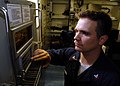 US Navy 071106-N-7981E-089 Electronics Technician 2nd Class Nolan Sobania checks the system configuration on the ship's WSN-7 internal navigation system aboard guided-missile destroyer USS Shoup (DDG 86).jpg