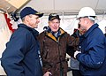 US Navy 080125-N-2510R-007 The Precommissioning Unit (PCU) George H. W. Bush (CVN 77) commanding officer, Capt. Kevin O'Flaherty, left, and former President George H. W. Bush, middle, speaks with a PCU Bush crewmember at the ai.jpg
