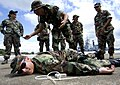 US Navy 080813-N-6266K-083 Master-at-Arms First Class Brentwood Paris lays on the ground.jpg