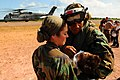 US Navy 080821-N-4515N-670 Cmdr. Angelia Elum-Oneal hands an Operation Smile patient to Lt. Cmdr. Maria Norbeck.jpg