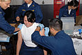 US Navy 090531-N-5586R-029 Boatswain's Mate Seaman Maria Orcillo receives both the anthrax and smallpox vaccines simultaneously aboard the aircraft carrier USS Ronald Reagan (CVN 76).jpg