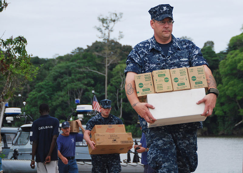 File:US Navy 090820-N-8138M-001 Culinary Specialist 2nd Class Howard T. LeRoy, foreground, and Ensign Michael P. Deasey, both assigned to the High Speed Vessel Swift (HSV 2) carry medical supplies ashore to resupply Ngola village.jpg