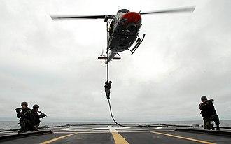 Fast-roping - Peruvian Marines fast-roping onto the BAP Quiñones (FM-58)