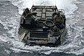 US Navy 091104-N-2218S-039 An amphibious assault vehicle from the 31st Marine Expeditionary Unit (31st MEU) returns to the amphibious transport dock ship USS Denver (LPD 9) after participating in a beach landing exercise.jpg