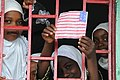 US Navy 091123-N-2420K-003 A student holds a drawing of an American Flag out of a classroom window during a dedication ceremony at the Nioumamilima Primary School in Nioumamilima.jpg