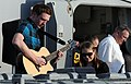 US Navy 091219-N-1291E-083 Culinary Specialist Seaman Jordan Gibala plays the guitar while Culinary Specialist Seaman Catherine Kidd plays the keyboard for the crew of the guided-missile cruiser USS Chosin (CG 65).jpg