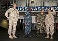 US Navy 100331-N-8936G-222 Officers speak in Nassau's hangar bay.jpg