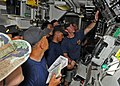 US Navy 100530-N-3446M-044 Chief Navy Diver Trey Williams explains the recompression chamber operation gages to a group of Indonesian navy divers.jpg