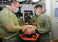US Navy 100819-N-7282P-001 Sailors aboard the amphibious assault ship USS Makin Island (LHD 8) transport a simulated patient infected with a contagious disease from an experimental isolation unit during a Limited Objective Expe.jpg