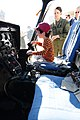 US Navy 110212-N-3659B-036 Lt. Jennifer Paulson shows a child the cockpit of a TH-57C Jet Ranger during the Centennial of Naval Aviation Open House.jpg