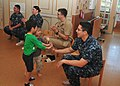 US Navy 111006-N-CG241-004 Aviation Ordnanceman Airman Bryan Rodriguez plays with children during a community service project at Hino Daycare.jpg