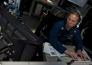 US Navy 111212-N-FI736-047 Lt. Greg Trach stands watch as the tactical watch officer in the combat information center aboard the Arleigh Burke-clas.jpg