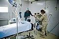 US Navy 120206-F-UI176-130 Moustaoha Abdilldhi, a local anesthesia nurse, and Lt. Heather Yurka, Camp Lemonnier anesthesiologist, set up an anesthe.jpg