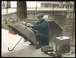 Umbrella repair man (6024678693).jpg