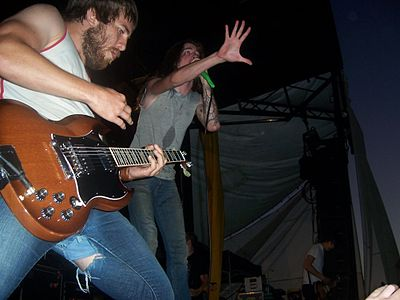 Guitarist Timothy McTague and vocalist Spencer Chamberlain performing at 2006's Warped Tour in San Diego, California. Underoath Warped06.jpg