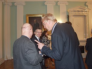 City Council of Helsinki - Helsinki mayor Jussi Pajunen (center) with leading city council members Chairman Minerva Krohn (background), Osmo Soininvaara (left), and Arto Bryggare (Right). Portrait of former chairman Alfred Norrmén on the wall.