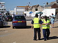 Wightlink staff directing traffic at Yarmouth Old Gaffers Festival 2011.JPG