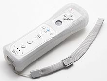 The Wii Remote, with a strap and a safety jacket.