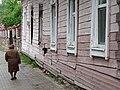 Woman Passing Wooden Facade - Polotsk - Vitebsk Oblast - Belarus (27526293912).jpg
